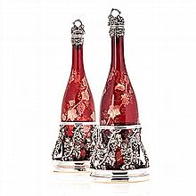 A SHEFFIELD PLATE-MOUNTED BOHEMIAN CRANBERRY GLASS DECANTER AND COASTER SET