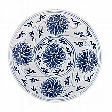 A CHINESE BLUE AND WHITE PLATE decorated with lotus surrounding a central r