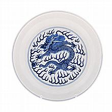 A CHINESE BLUE AND WHITE PLATE painted with a dragon chasing a flaming pear