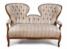 A CONTINENTAL CHERRYWOOD CAMELBACK SETTEE, 19TH CENTURY the padded button-b