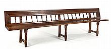 A DUTCH PROVINCIAL OAK BENCH the moulded top rail above turned spindles, ha