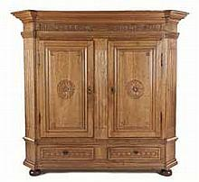 A DUTCH OAK CUPBOARD, 19TH CENTURY the moulded outswept top with canted cor