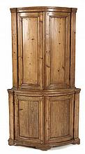 A DUTCH PINE BOWFRONTED CORNER CUPBOARD, 19TH CENTURY the moulded pediment