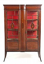 AN EDWARDIAN MAHOGANY AND INLAID DISPLAY CABINET the shaped cornice above a