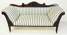 A REGENCY MAHOGANY SETTEE the curved and foliate-carved top rail above a pa