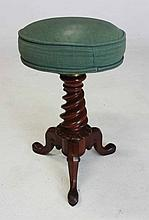 A WILLIAM IV MAHOGANY PIANO STOOL the circular revolving padded seat on a t