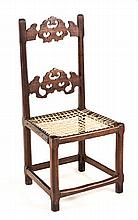 A CAPE STINKWOOD SIDE CHAIR the carved and pierced top and mid-rail between