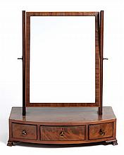 A GEORGE II FLAME MAHOGANY TOILET MIRROR the rectangular plate within a con