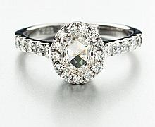 A DIAMOND RING collet set to the centre with a cognac-coloured cushion-cut