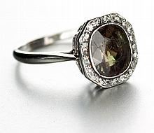 AN ALEXANDRITE AND DIAMOND RING the octagonal motif centred with a cushion-