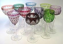 A MISCELLANEOUS GROUP OF COLOURED CUT-GLASS DRINKING GLASSES of various col