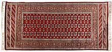 A PAKISTANI RUG, MODERN the red field with three r