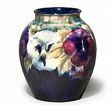 A WILLIAM MOORCROFT 'PANSY' PATTERN VASE green pai