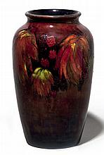 A WILLIAM MOORCROFT 'FRUIT AND BERRY' PATTERN FLAM