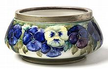 A WILLIAM MOORCROFT 'WHITE PANSY' PATTERN BOWL wit