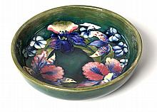 A MOORCROFT 'ORCHID PATTERN DISH painted initials,