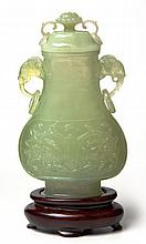 A CHINESE CARVED JADE PEAR-SHAPED TWO-HANDLED VASE