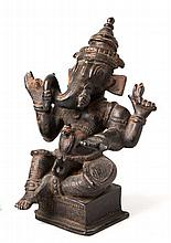 AN INDIAN PATINATED BRONZE FIGURE OF GANESH seated