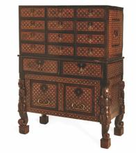 AN INDO-PORTUGUESE EBONY AND WALNUT INLAID CABINET-ON-STAND in two parts, t