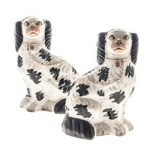 A PAIR OF STAFFORDSHIRE BLACK AND WHITE SPANIELS, 19TH CENTURY each seated,