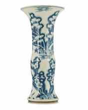 A CHINESE BLUE AND WHITE GU-SHAPED BEAKER VASE the upper section with magno