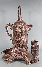 ANTIQUE PAIRPOINT SILVER PLATE TILTING ICE WATER PITCHER: