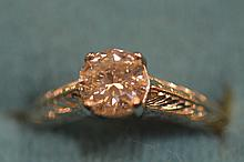 A diamond single stone ring in platinum claw setti