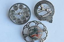Three various silver brooches. Est. £10 - £15.