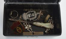 A laquered box containing costume jewellery. Est.