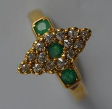 An attractive emerald and diamond marquise shaped