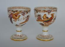 A pair of Royal Crown Derby cups decorated with fl