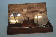 A pair of silver mounted and steel scales in mahog
