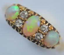 An opal and diamond seven stone half hoop ring in