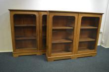 A good pair of oak glazed bookcases on bracket fee