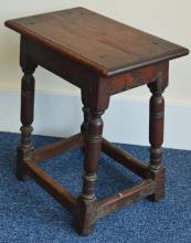 A period style oak joint stool having turned legs