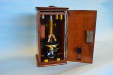 A good cased brass mounted microscope