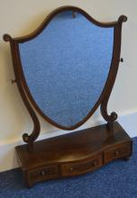A bow front Edwardian toilet mirror with strong in