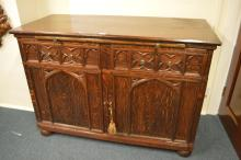 A good oak carved gothic sideboard with brass hand