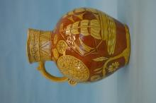 A good early 20th Century slipware Harvest jug dec