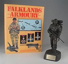 1982: Falklands War Royal Marines presentation figure, Argentinean helmet and book