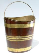 A George III brass-bound mahogany navette-shaped oyster bucket