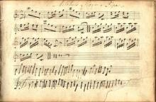 A collection of Irish sheet music and a manuscript music notebook
