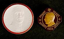 1933. Adolf Hitler commemorative porcelain medal and Bakelite badge.   (2)