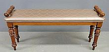 English walnut narrow bench with turned legs, side grips and upholstered seat. 20.5