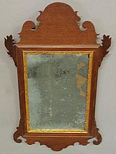 Small Chippendale mahogany mirror, c.1780, with a carved crest and ears. 22