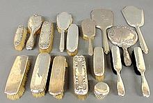 Large grouping of sterling silver dresser sets.