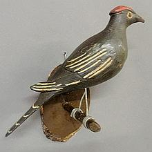 Large carved and paint decorated bird, late 19th c., perched on a branch. 15