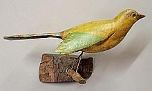 Large carved wood and paint decorated bird mounted on a twig and tree branch section, probably late 19th c. 9