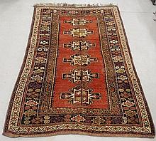 Kazak style oriental center hall carpet with red field and six center medallions. 6'4
