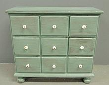 Pine apothecary chest with blue paint decoration and porcelain knobs. 26